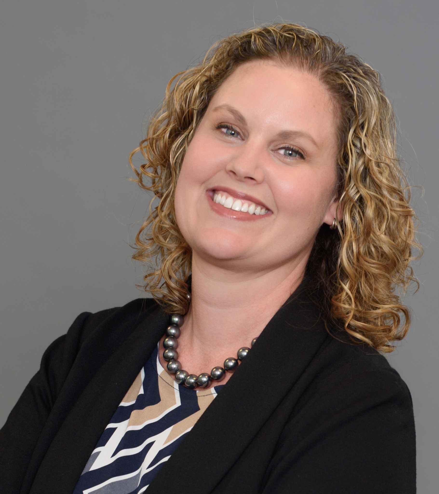 Headshot of Christie Coats, Director of Real Estate